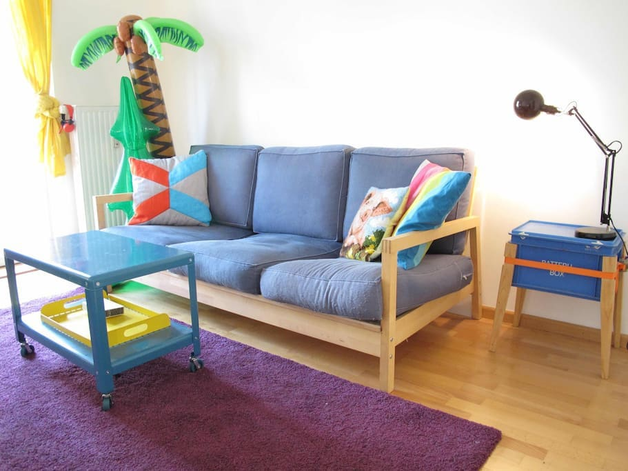 Living room with sleeping couch and inflatable oasis