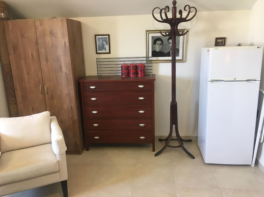 Couple suite with a closet and refrigirator