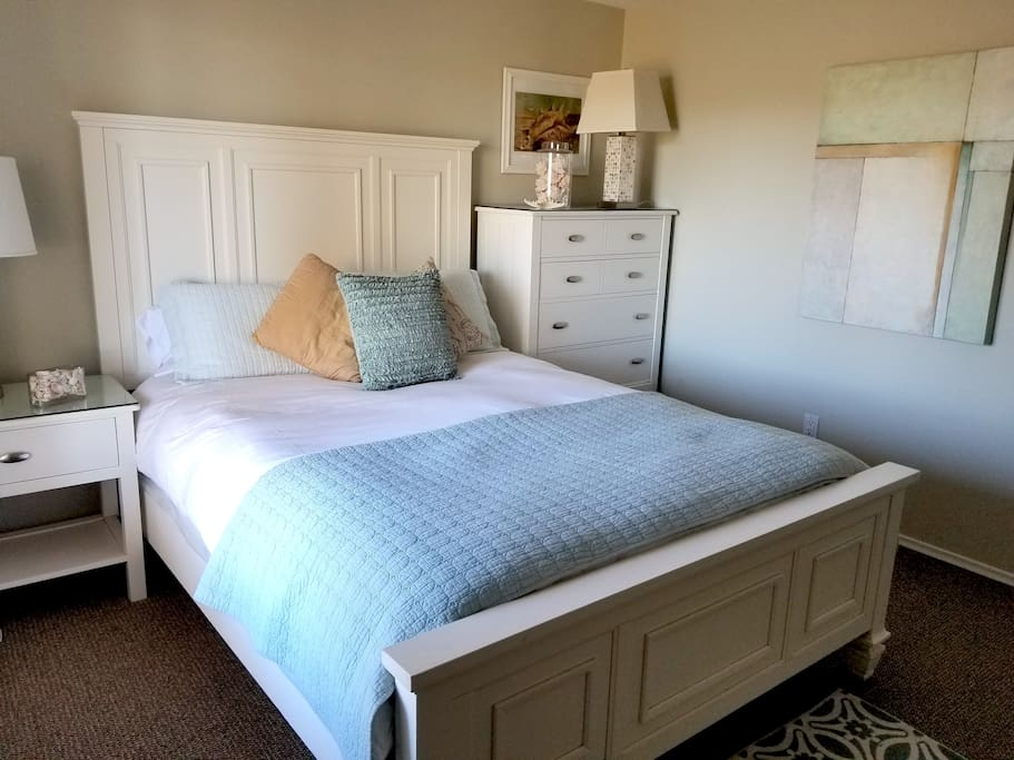 Queen bed with side table and dresser
