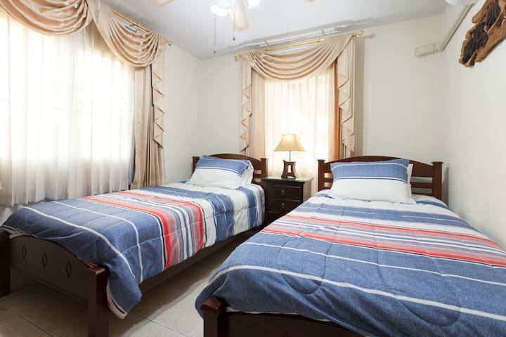 Twin bedroom located on the main floor
