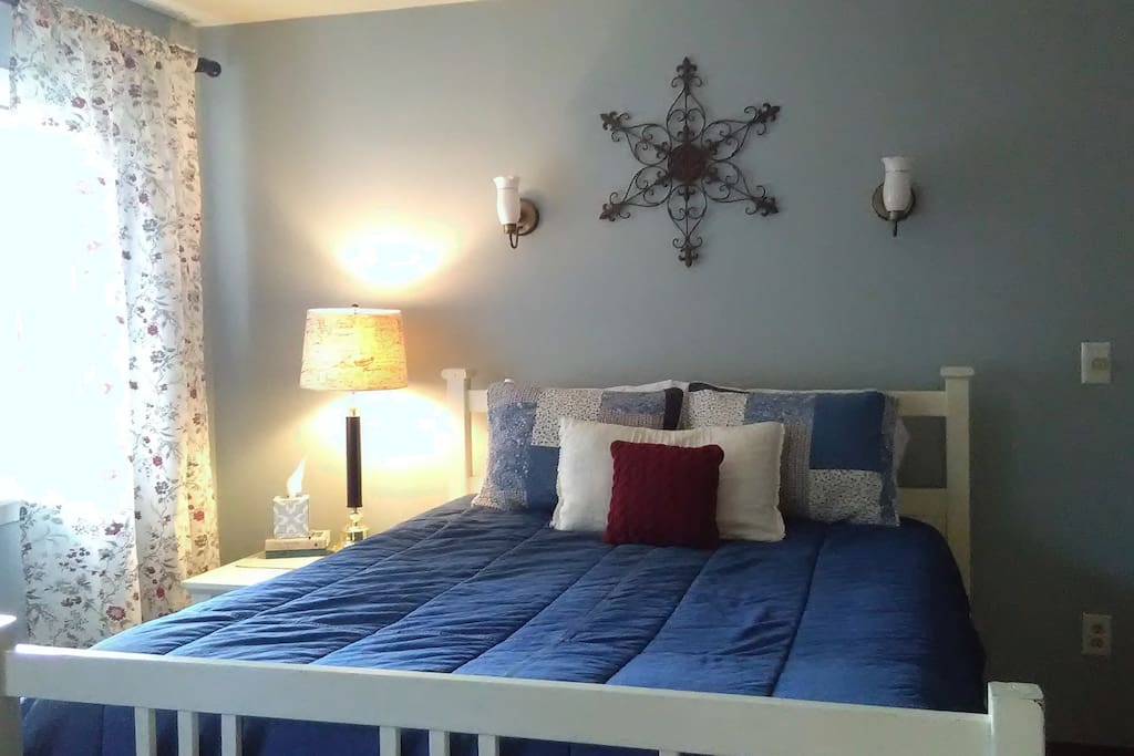 """Welcome! The walls of the main bedroom have now been painted a restful bluish gray called """"at peace."""""""