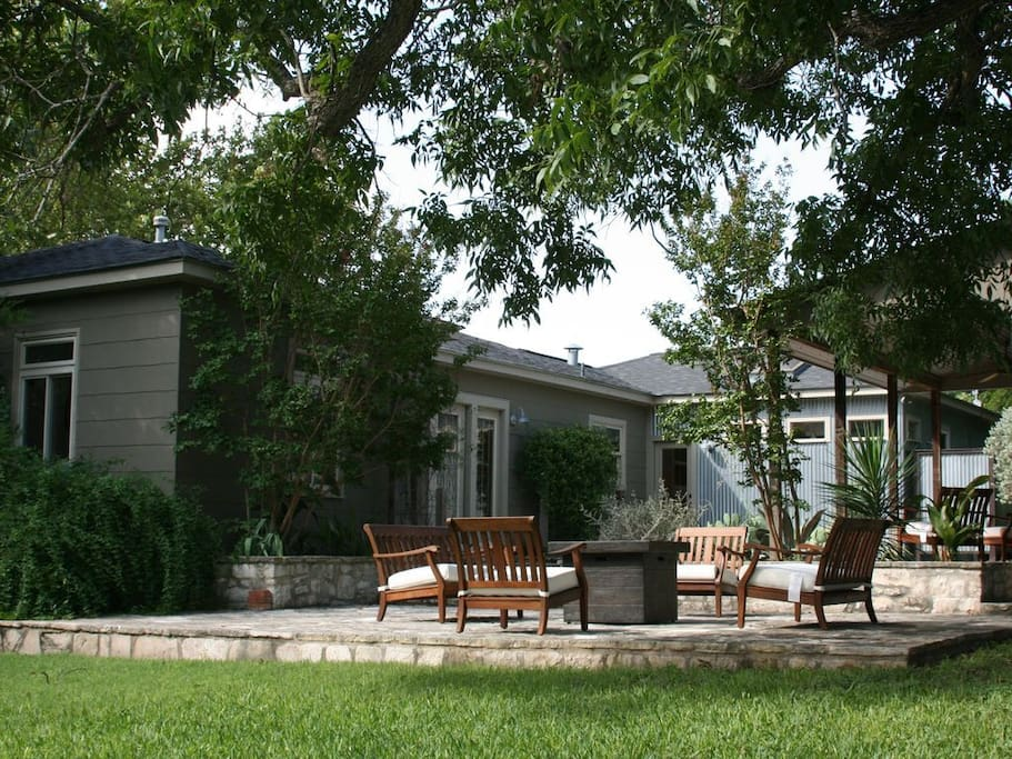 One of the things we love most about this house is the spacious outdoor patio and fire pit.