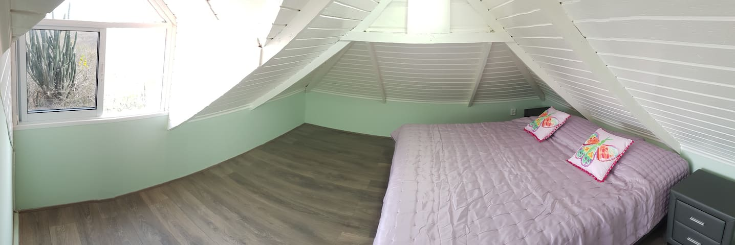 1 Attic Bedroom with queen sized box spring bed air-conditioned.
