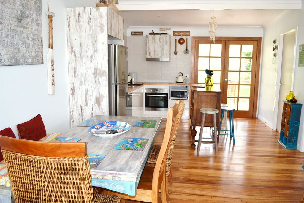 'Haven's' open plan kitchen and dining area in stylish 'Rustic Coastal' decor