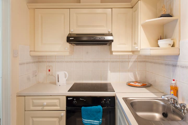 Bright small kitchen has everything necessary for comfortable stay