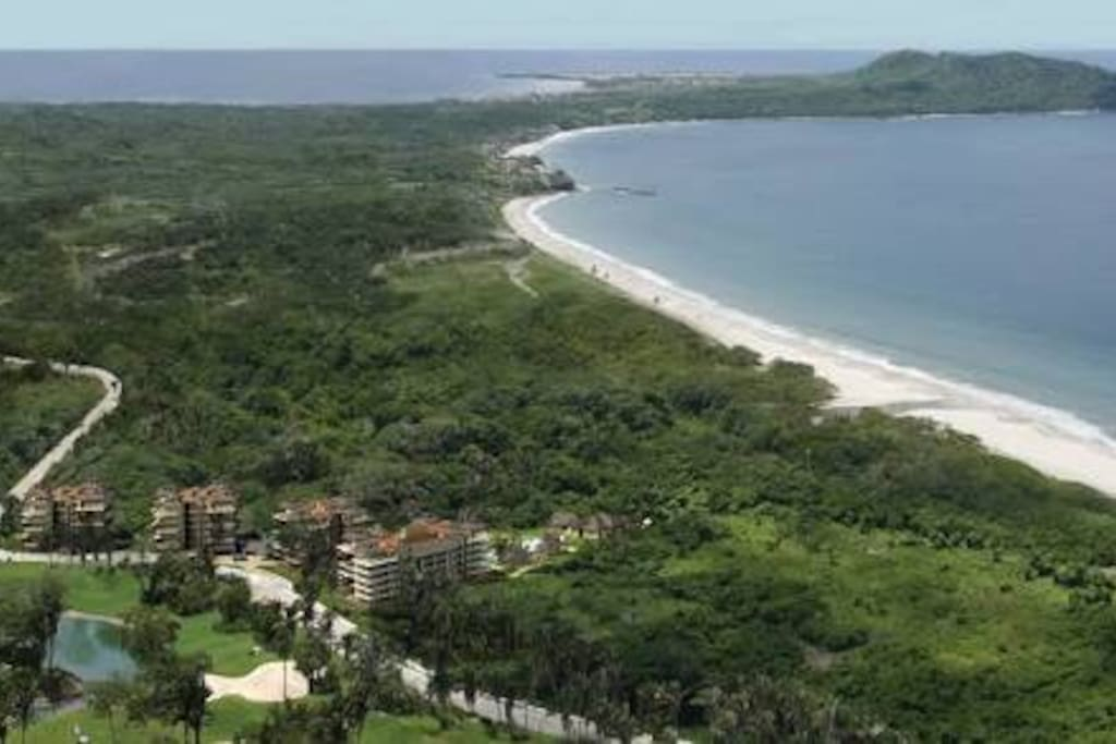 Located by a mangrove swamp, access to the beach by the eighteen hole's green .