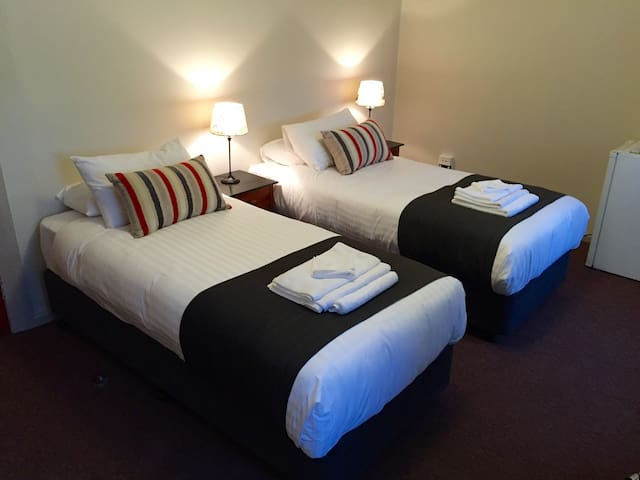 Twin single beds (also available as King bed).