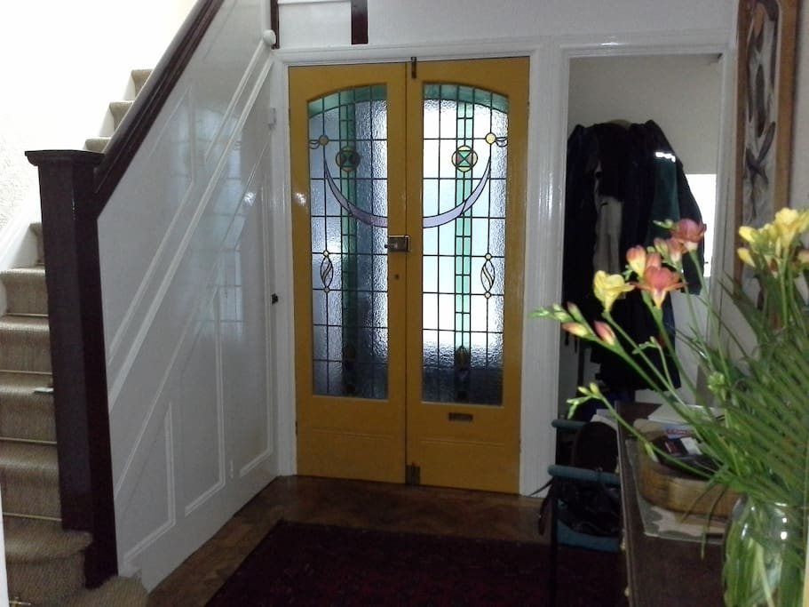 Entrance hall with original stained glass front door.
