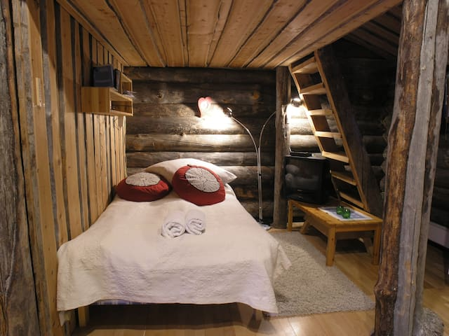 Bed downstairs and stairs to upstairsbed on the righthand side.