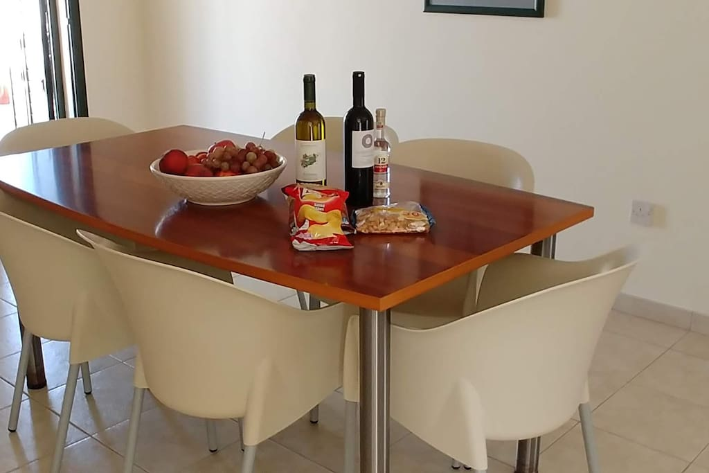Dining table with welcome drinks and fruit