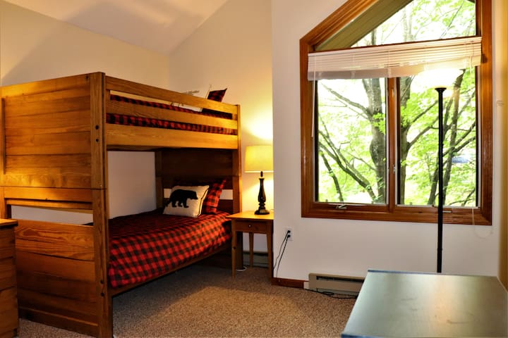 bunk room with 4 twin beds and full bath, 2nd level.  Fan available.  AC unit in master BR across hall.