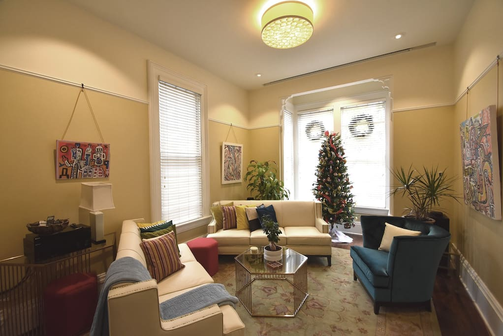All the living room furniture has been replaced with updated new pieces that work better with the flow of the room. The tree and window wreaths are temporary for the December holidays.
