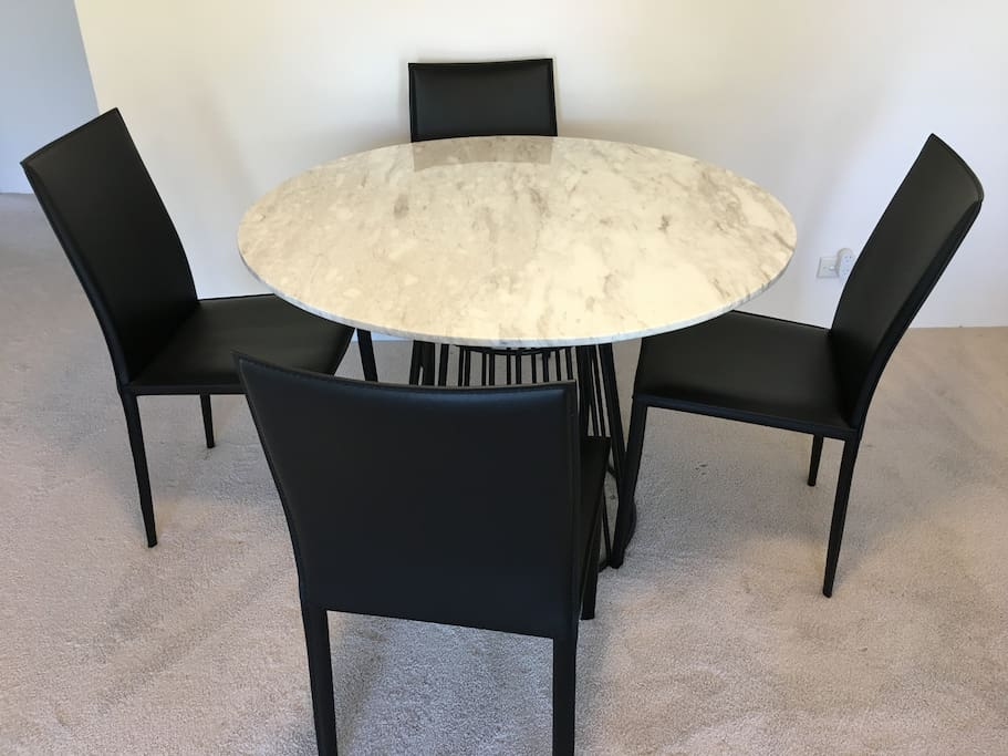 Marble dining table with leather chairs