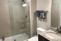 Upstairs full bath with glass shower!