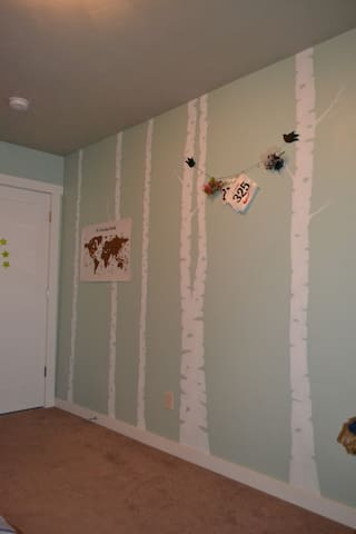 There is a full wall mural of white birch trees in the room you will be renting.