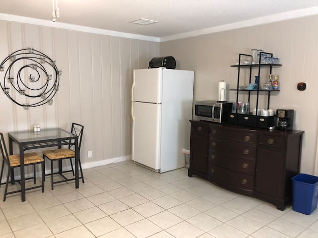 Small kitchenette has full size fridge, microwave, toaster oven, and coffee pot.