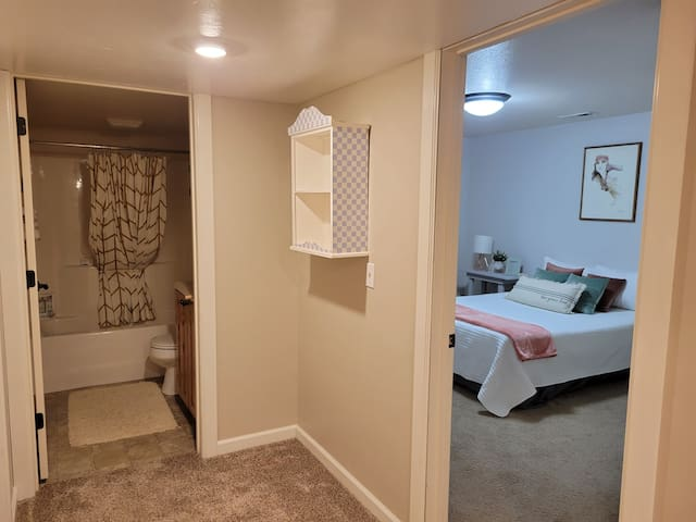 Lower level area leading to bedroom and full bathroom.
