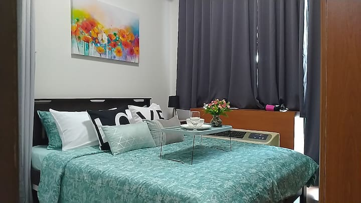 Eastwood City 1BR Condo above Mall w/ WIFI+NETFLIX