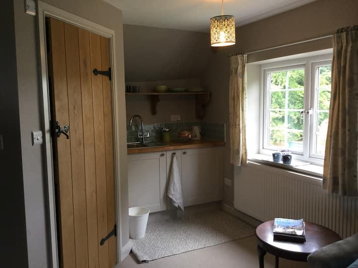 Luxury farmhouse attic suite with bijou kitchen
