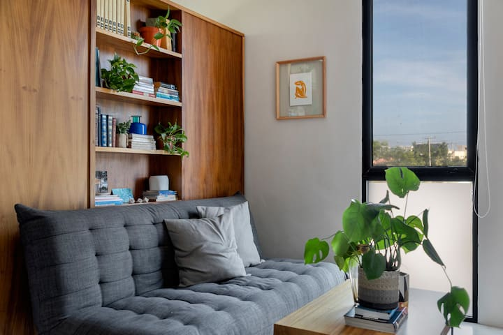 Sofa bed. Coffee table. Ceiling fan. Air Conditioner.