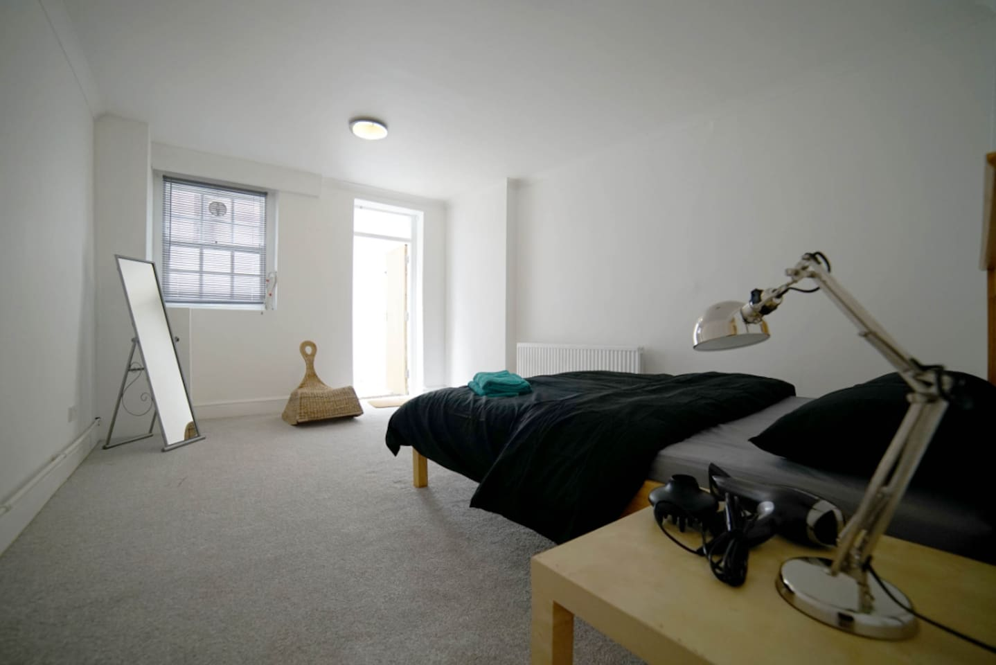 Spacious ground floor room with a king sized bed and your own private decked garden space.