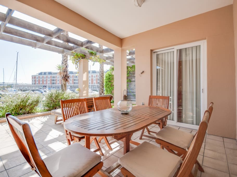 Veranda overlooks the marina and has two loungers for soaking up the sun and spectacular view.