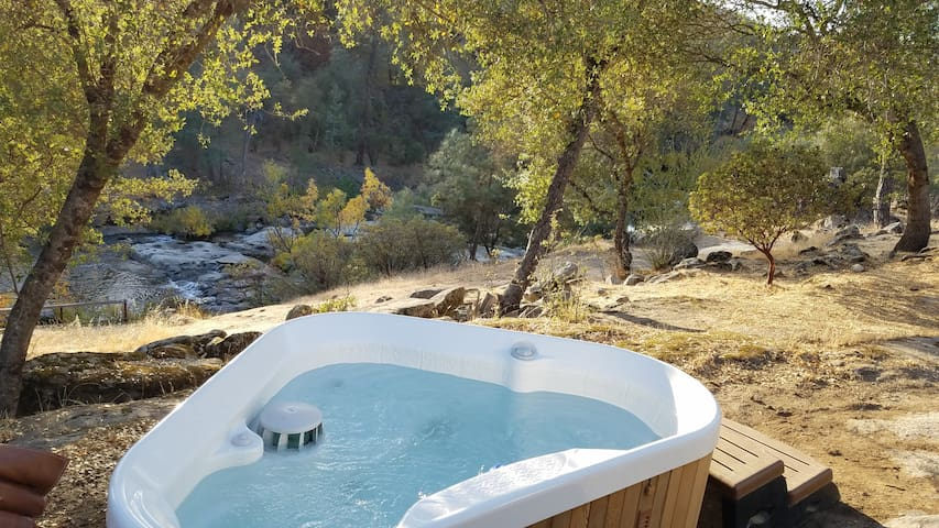 Private hot tub overlooking the river.