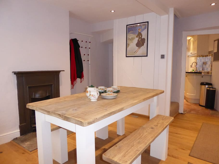 The dining room has oak flooring, and is open plan with the kitchen on the ground floor.