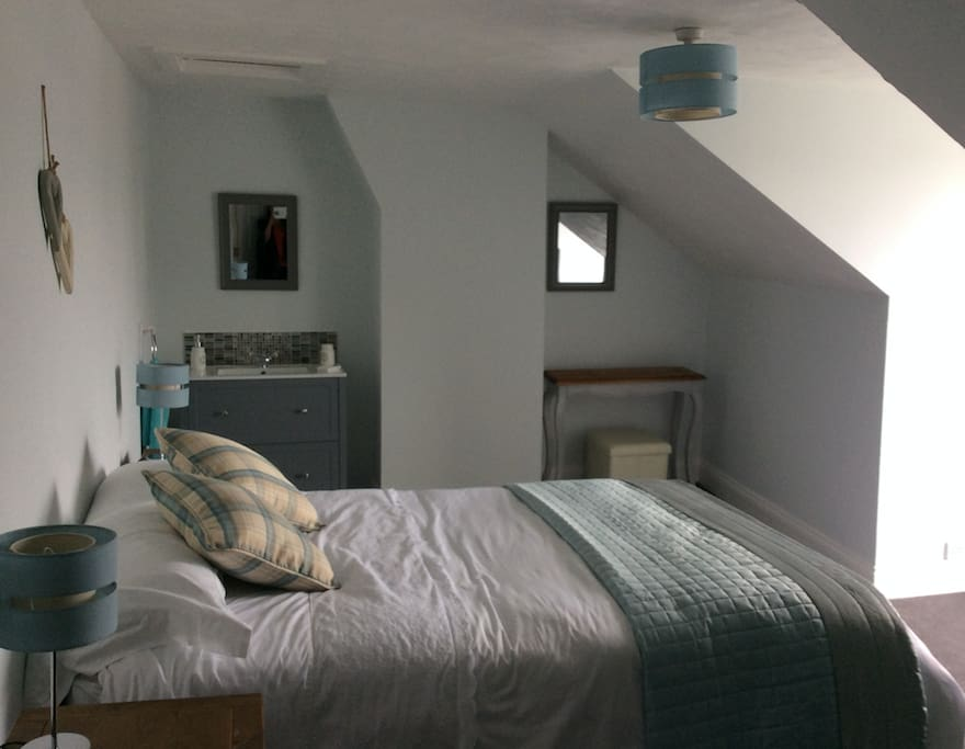 Master double bedroom with extensive views of the Exe Estuary and hills and valleys beyond.