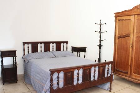 Suíte confortável em casa no São Bento