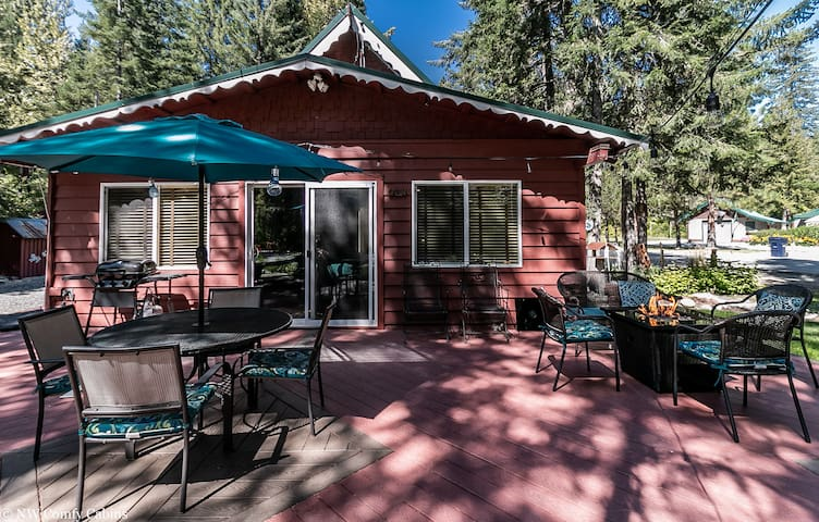 An enchanting front deck with all of the comforts to enjoy a hammock with a good book, s'mores with the kids on the propane firepit, a BBQ with friends and stargazing with your honey.