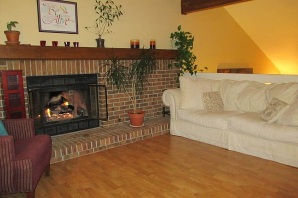 Upstairs living room big cozy couch & fireplace