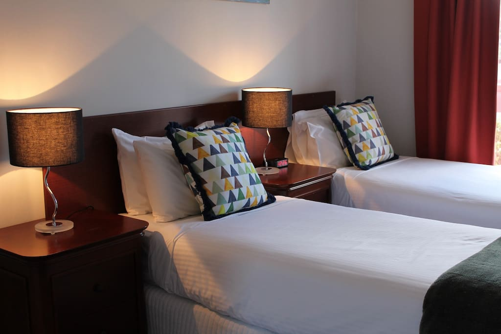 You can choose either 2 single beds or a queen bed in the 2nd bedroom