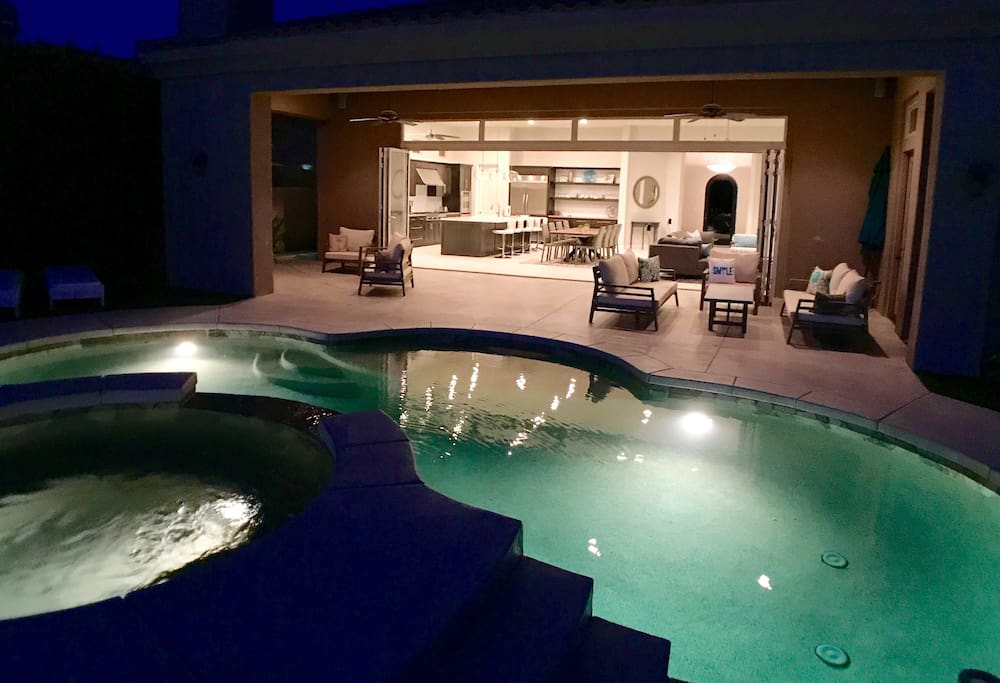 Enjoy the pool and hot tub day or night