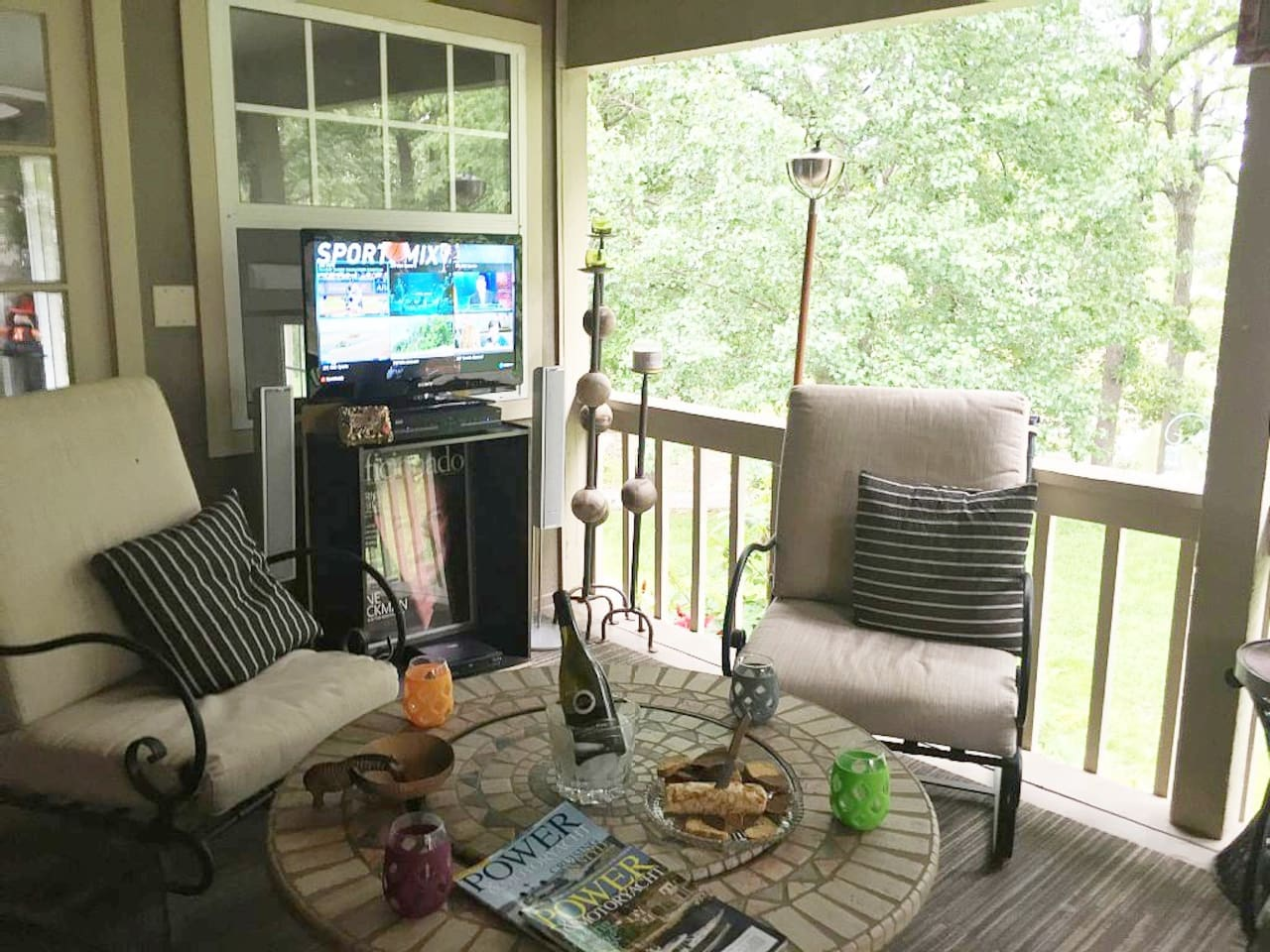 Popular covered deck offers lake view & large back yard. Walking distance to lake & marina. Deck Features include   Direct TV, Home Theater Surround Sound. Luxury Deck furniture, fire pit,  2 ceiling fans, torches, & abundant hummingbirds & wildlife.