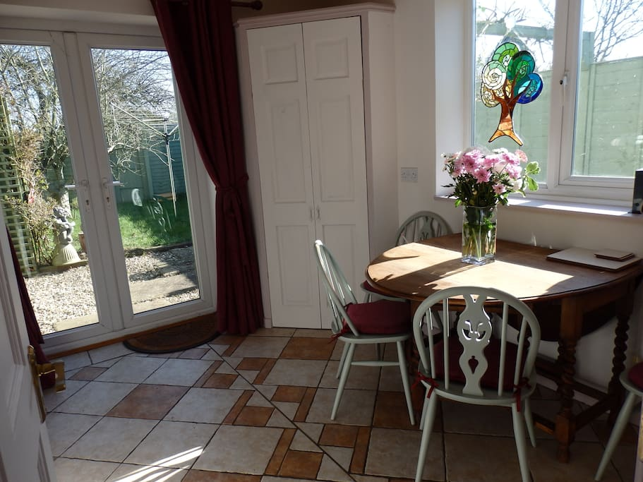 Dining room with french windows opening on to the garden