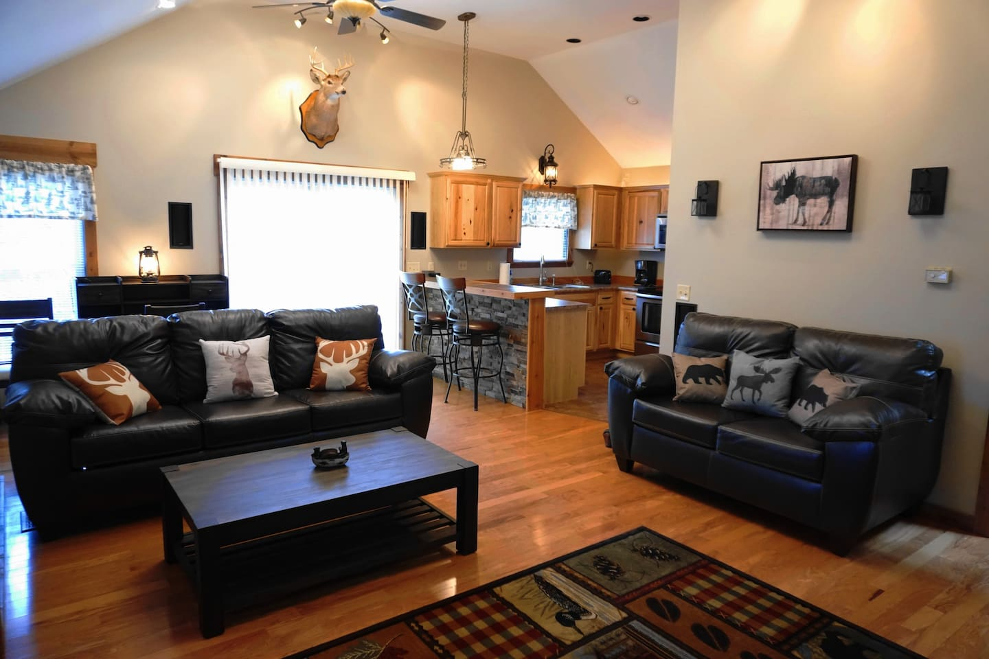 Welcome to The Lodge.  Vaulted ceilings and a lodge themed décor are warm and inviting.  The full size sofa has a pull out memory foam mattress for extra guests.  Sliding doors serve as your entrance and access to private deck with scenic views.