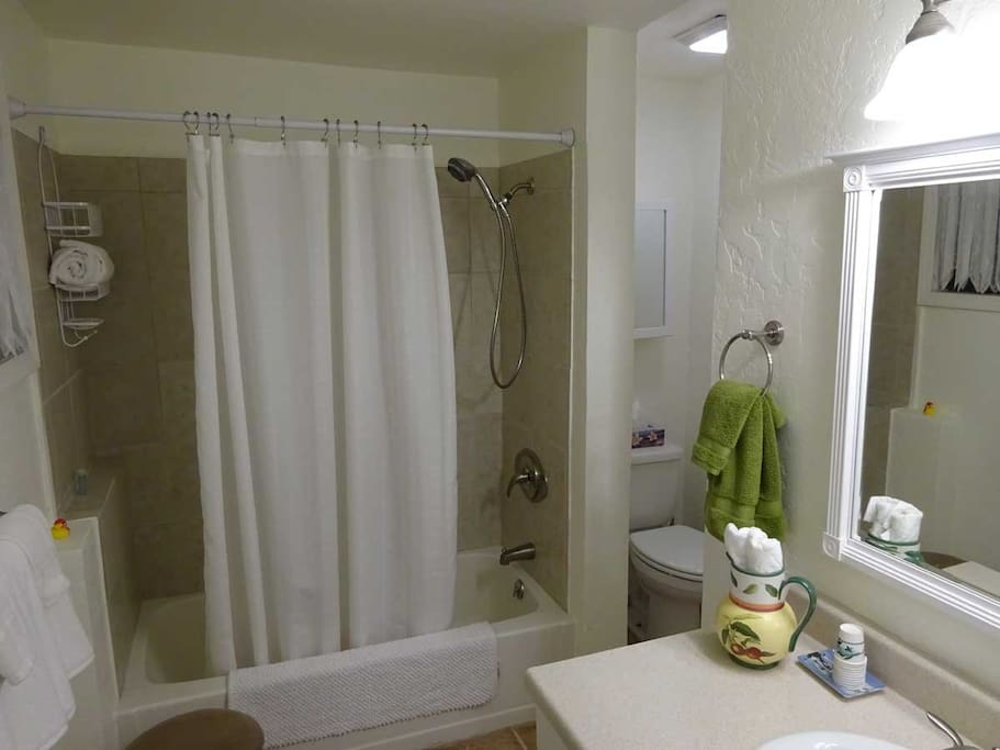 Private bathroom with towels, washcloth, small soaps, personal shampoo.