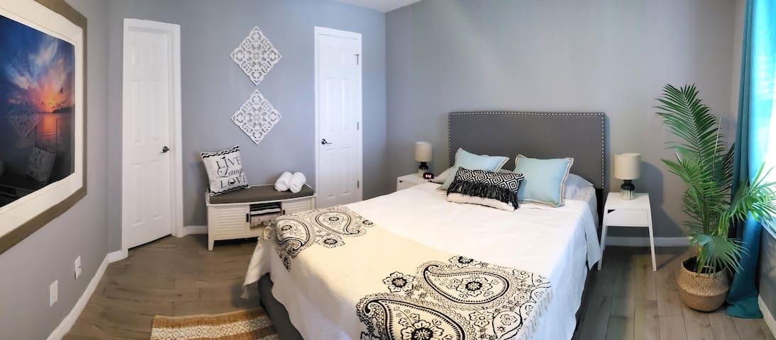 Bedroom, showing bench and closet door