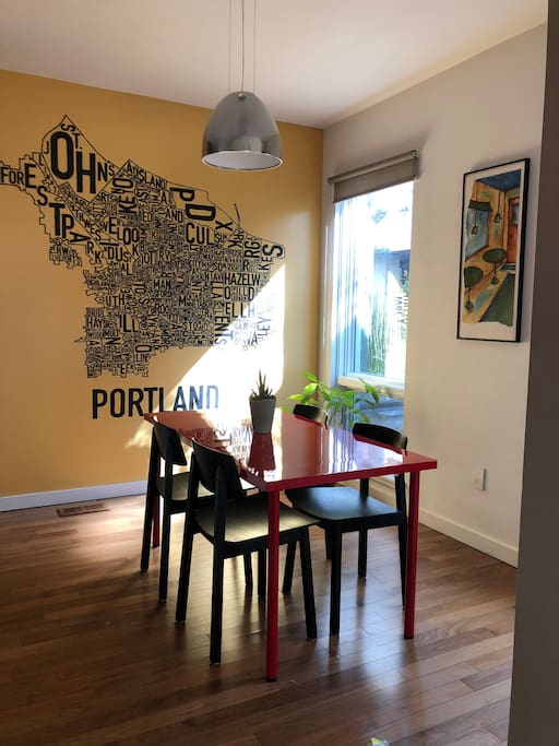 The dining room is to the right when you walk in. The mural (which I made myself!) shows different Portland neighborhoods.