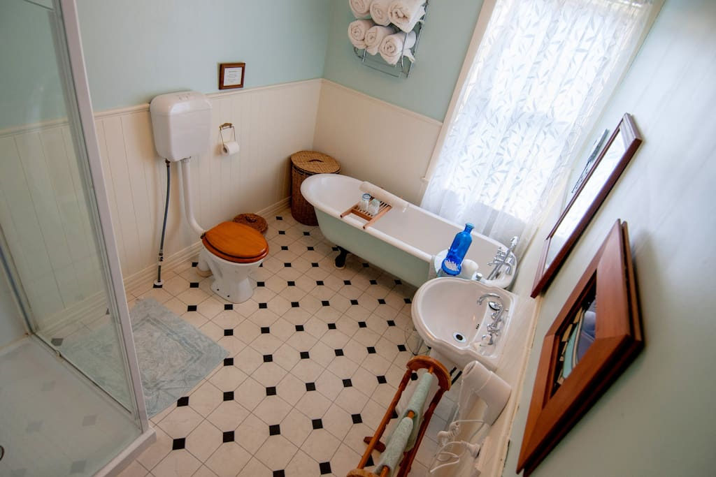 One of the 2 bathrooms shared between 6 heritage rooms