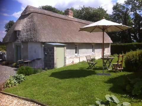 2 px entire thatched cottage with wood stove