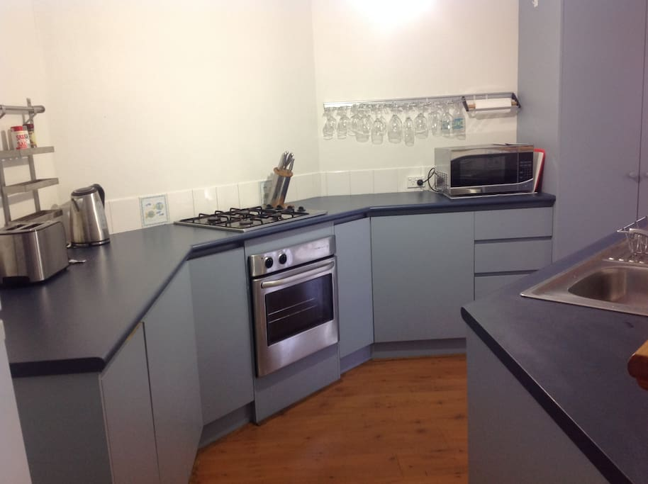 A fully equipped kitchen with microwave and dishwasher