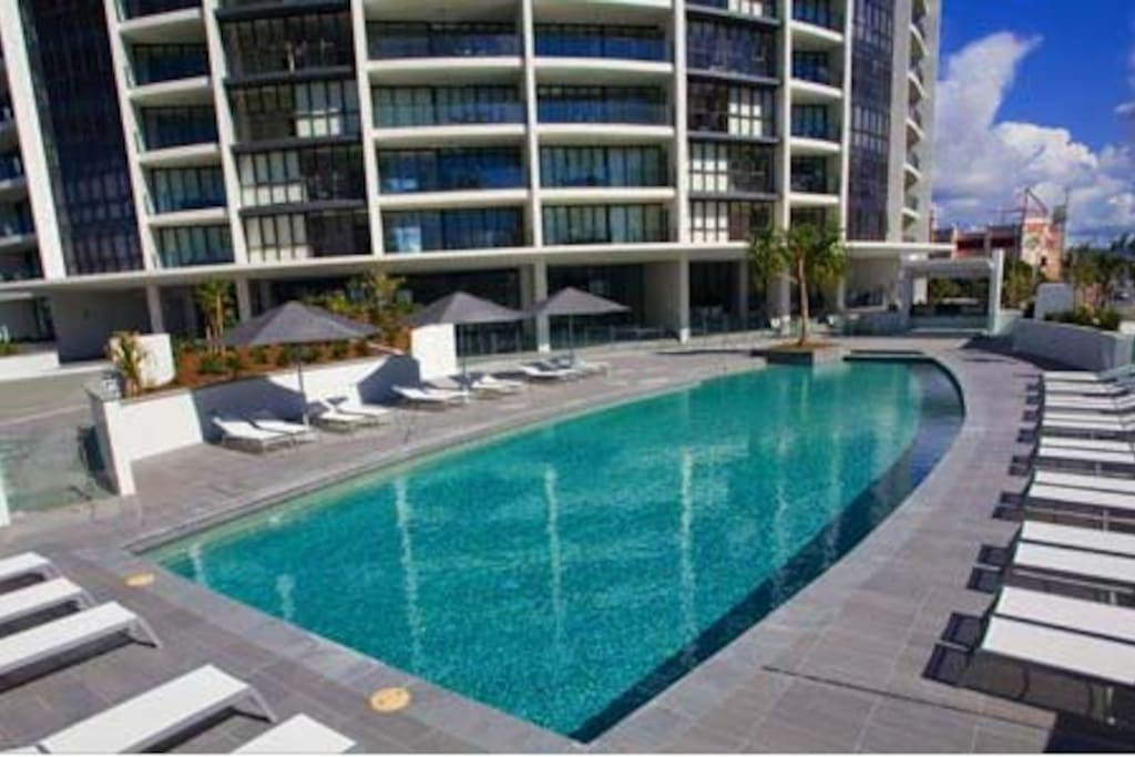 Relax by the resorts pool. Pool towels are provided and are stored in the apartment.