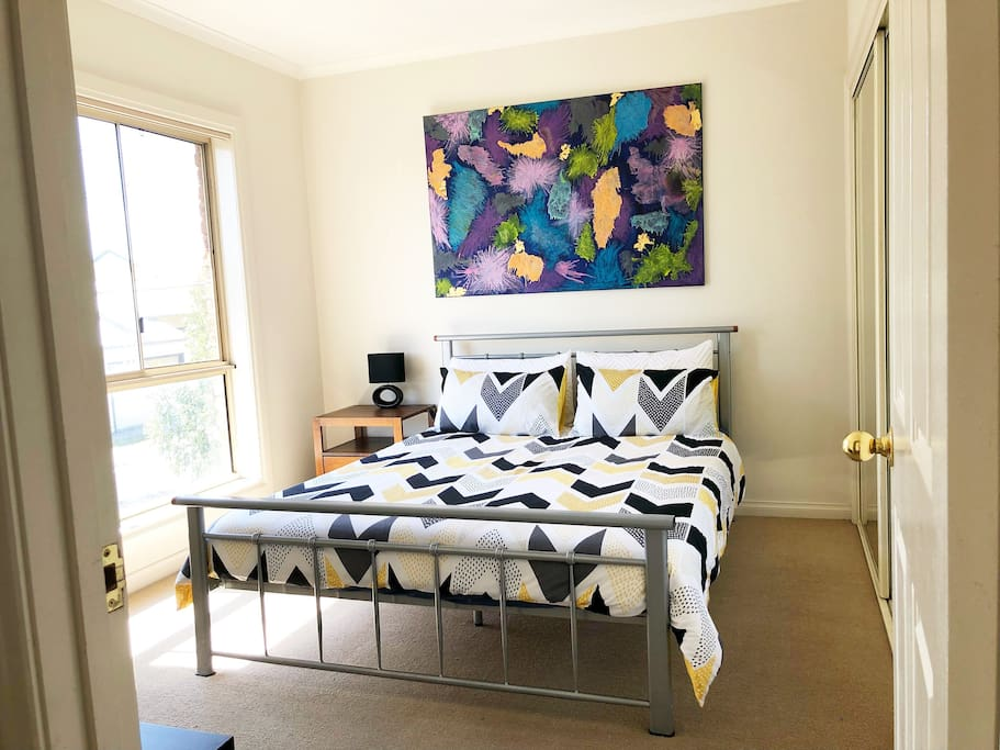 Queen bed with optional single folding bed.