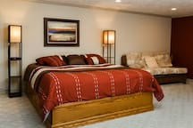 Spacious bedroom with a very comfortable King size bed, queen size hide a bed and plenty of closet storage space.