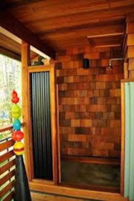 Outdoor shower is great year round (the concrete pad heats up in seconds, really)