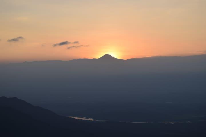 The sun behind the Nevado del Tolima