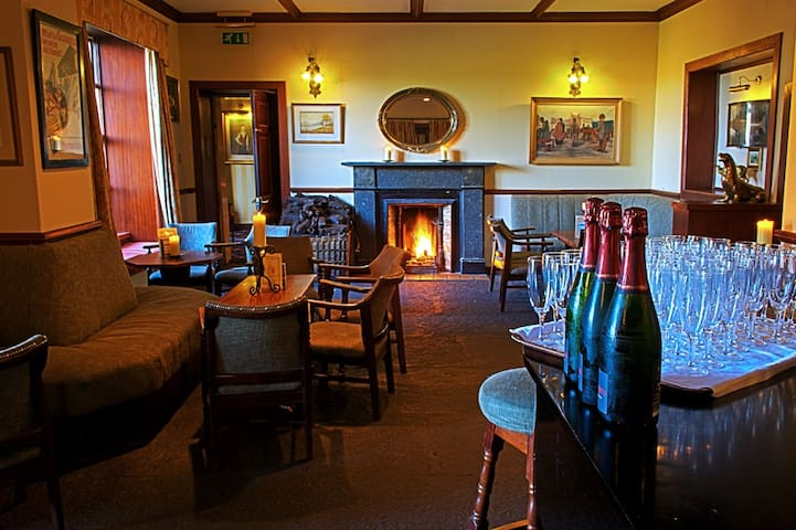 Complimentary Champagne and Talk about the area in our Piano Bar at 6