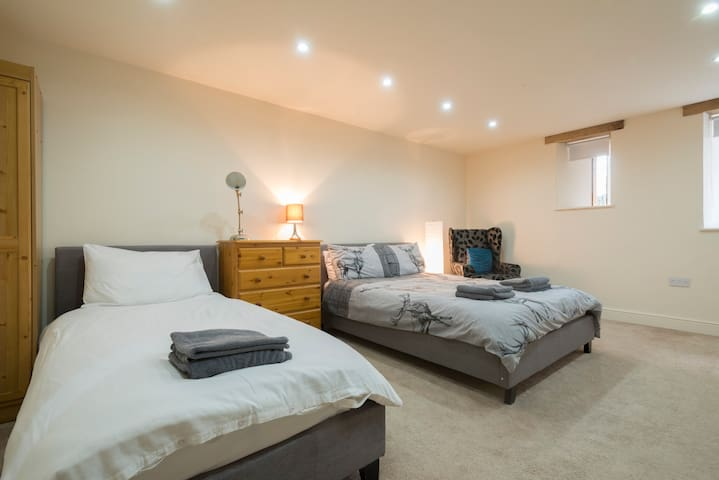 Bedroom 4 has a double bed and a single bed and also has an ensuite shower room